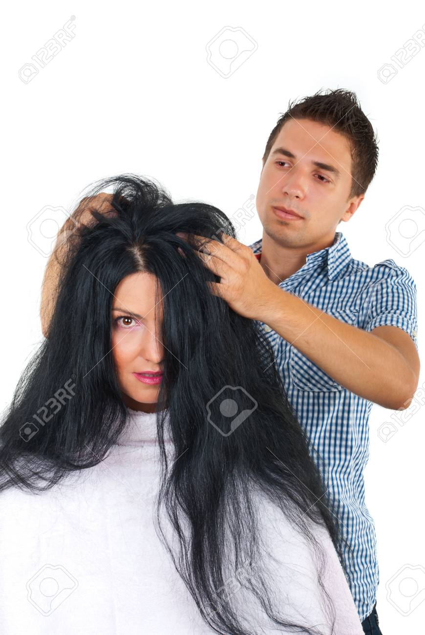 Professional hairdresser  with a customer woman with long hair who looks a bit scared Stock Photo - 7564771