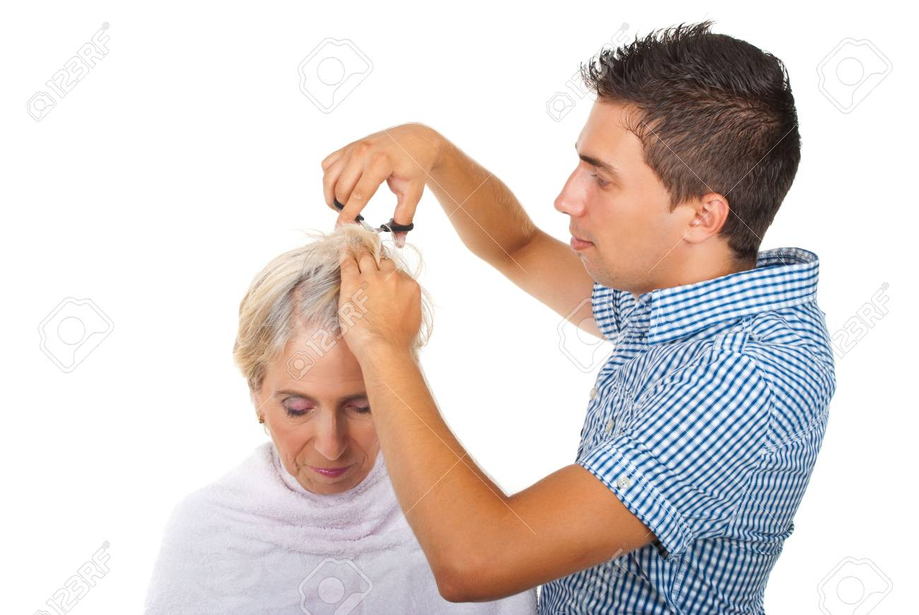 Young hairstylist cut senior woman hair isolated on white background Stock Photo - 7590112