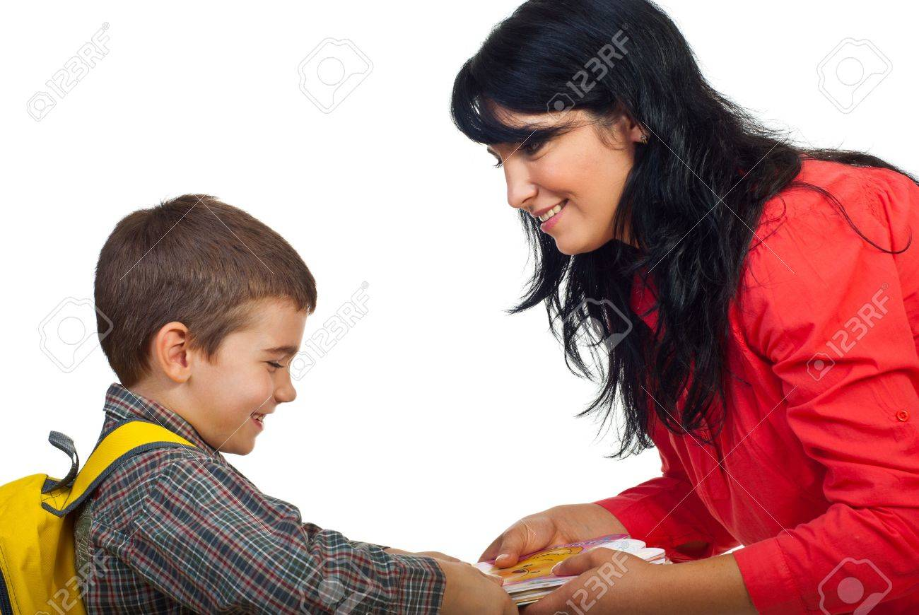 Smiling mother giving books to her son and the boy  laughing and take the books and preparing for school isolated on white background Stock Photo - 7907827