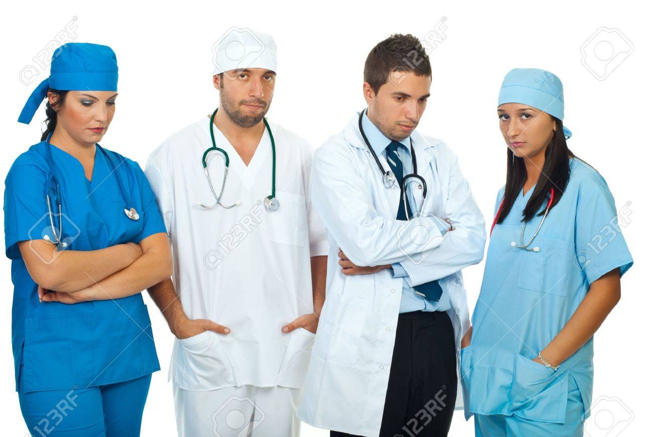 7985459-Disappointed-team-of-different-doctors-standing-in-a-row-and-looking-down-or-at-camera-isolated-on-w-Stock-Photo.jpg