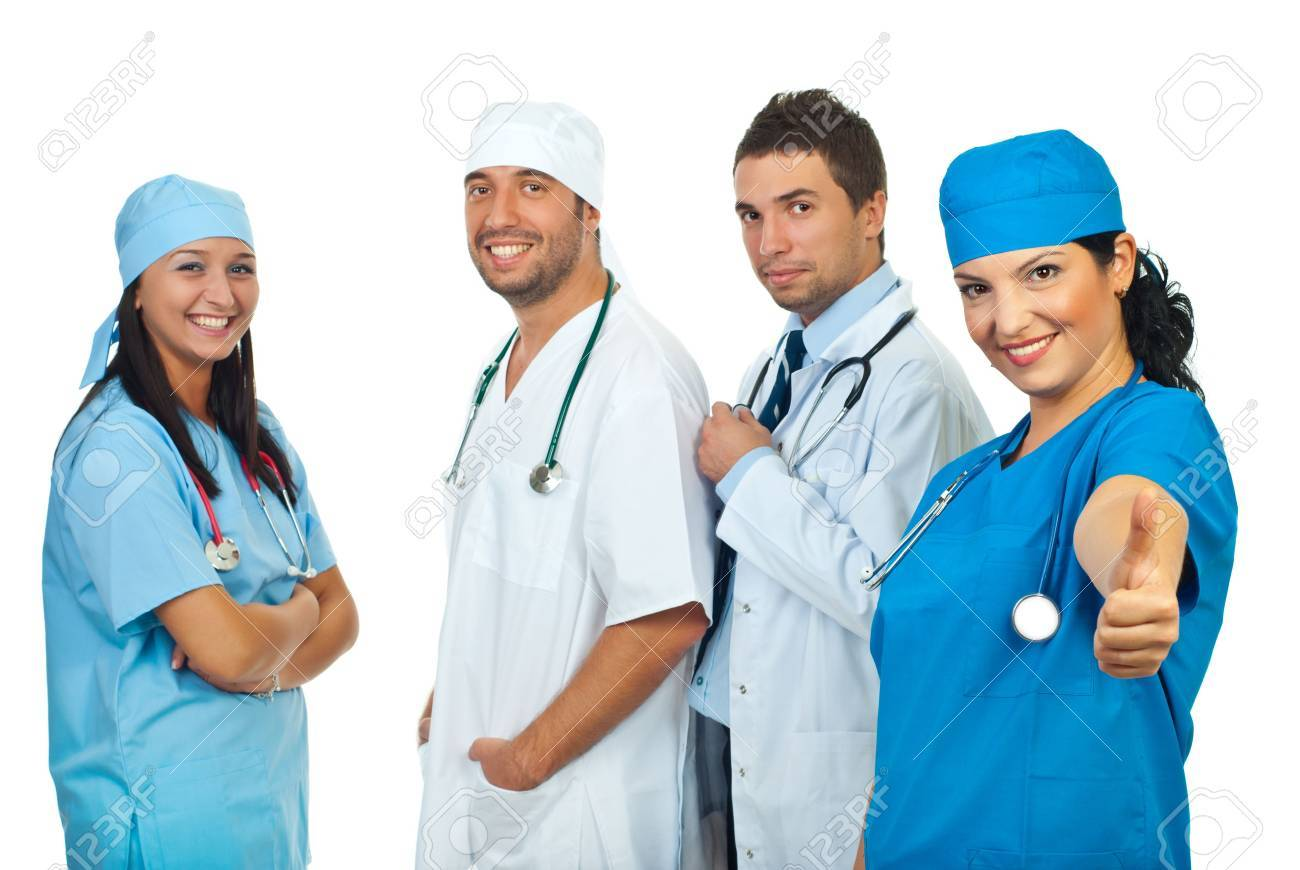 Happy surgeon woman giving thumbs up and her team smiling in background Stock Photo - 7985506