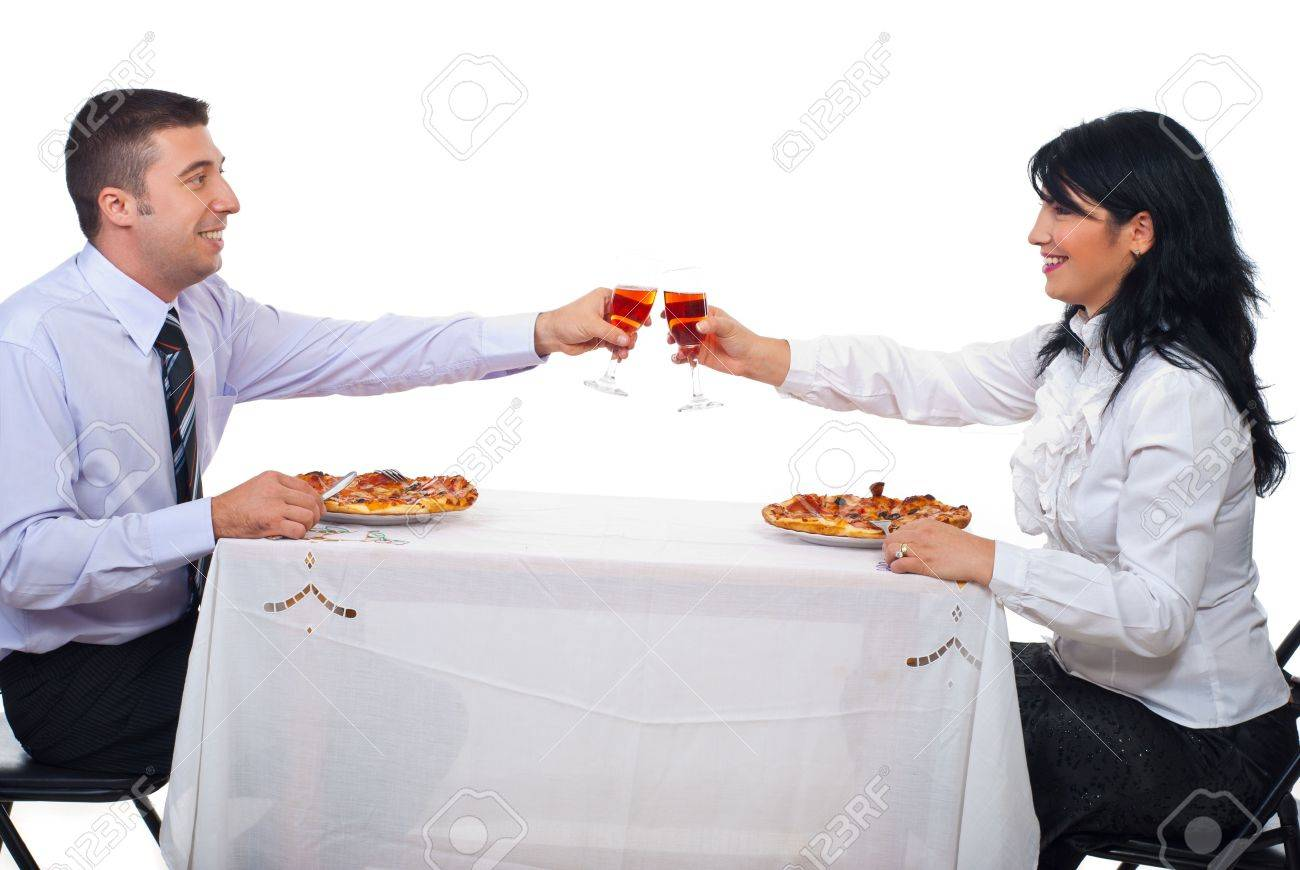 Eating Table Two Business People Toasting With Wine And Eating Pizza At Stock