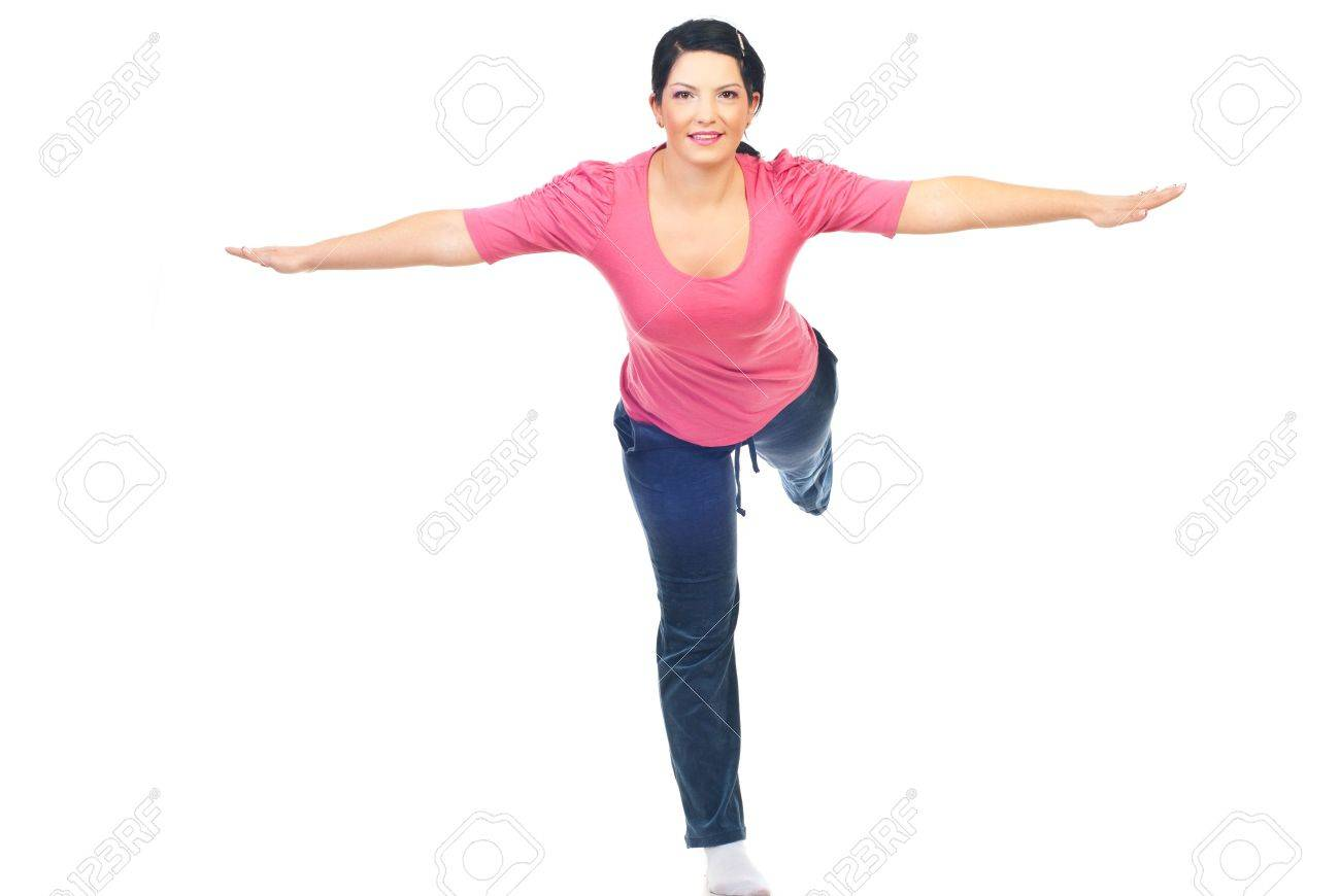 Woman  doing sport and standing in a leg with both hands and one  leg  outstretched isolated on white background Stock Photo - 8156383