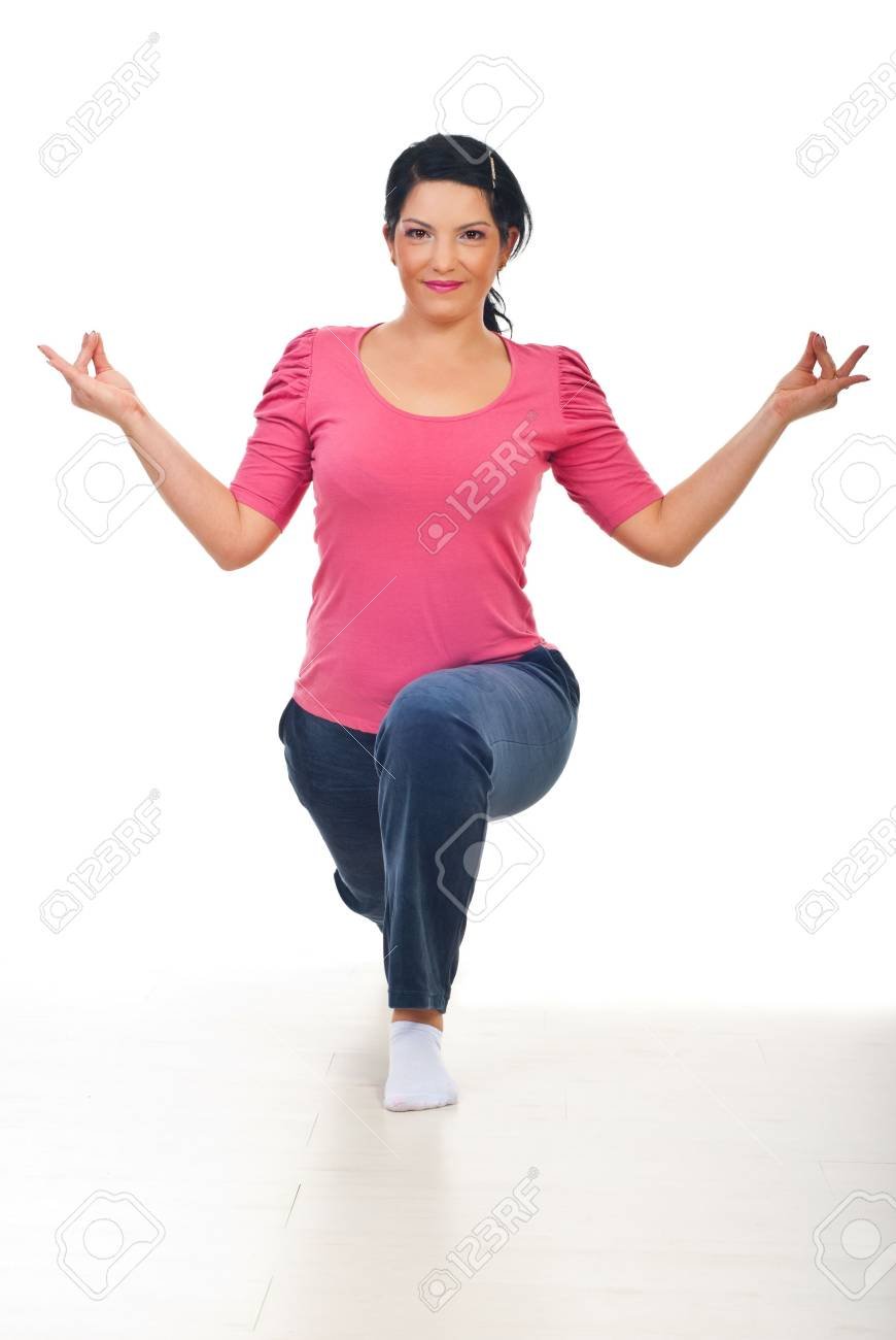 Smiling mid adult woman in yoga position  on floor over white background Stock Photo - 8156385