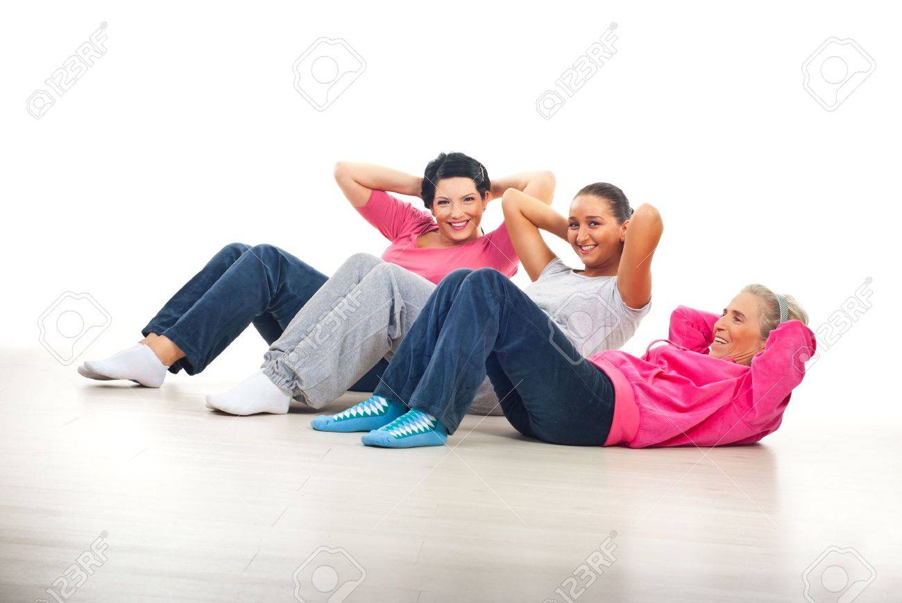 Laughing happy women having fun and doing abs on floor over white background Stock Photo - 8156390