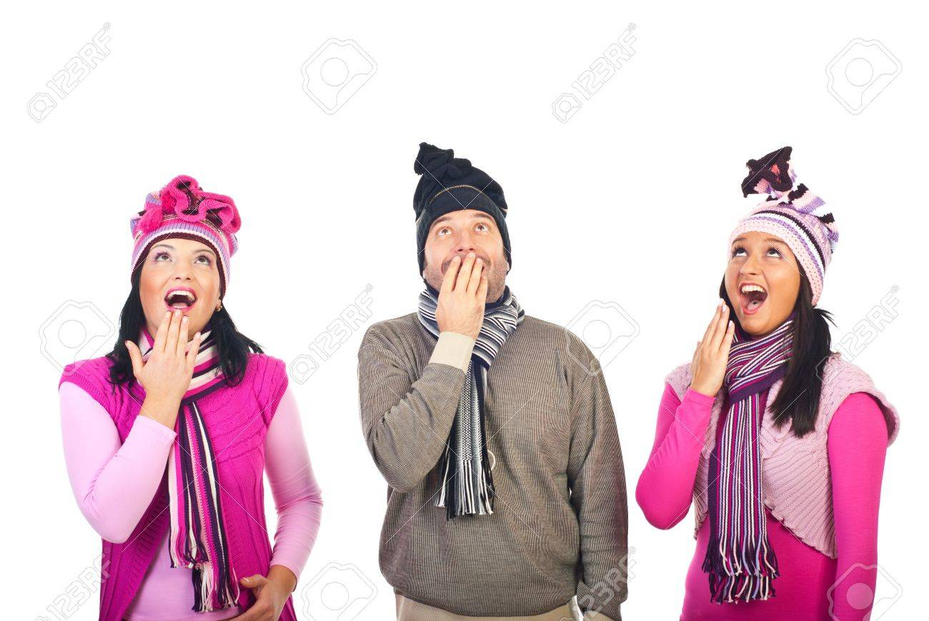 Surprised happy group of three people friends in a row looking up to copy space  isolated on white background Stock Photo - 8156426