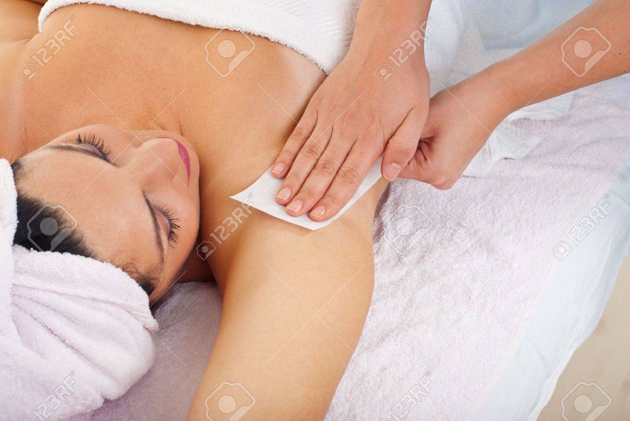 Close up of woman getting waxing armpit by beautician in a beauty salon Stock Photo - 8270393