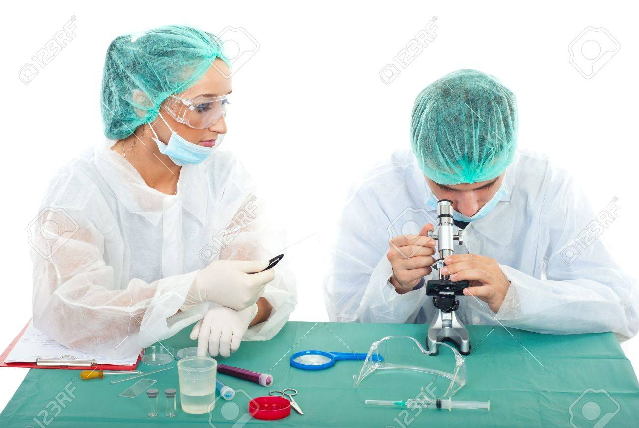 Two young scientists people working in laboratory Stock Photo - 8333083