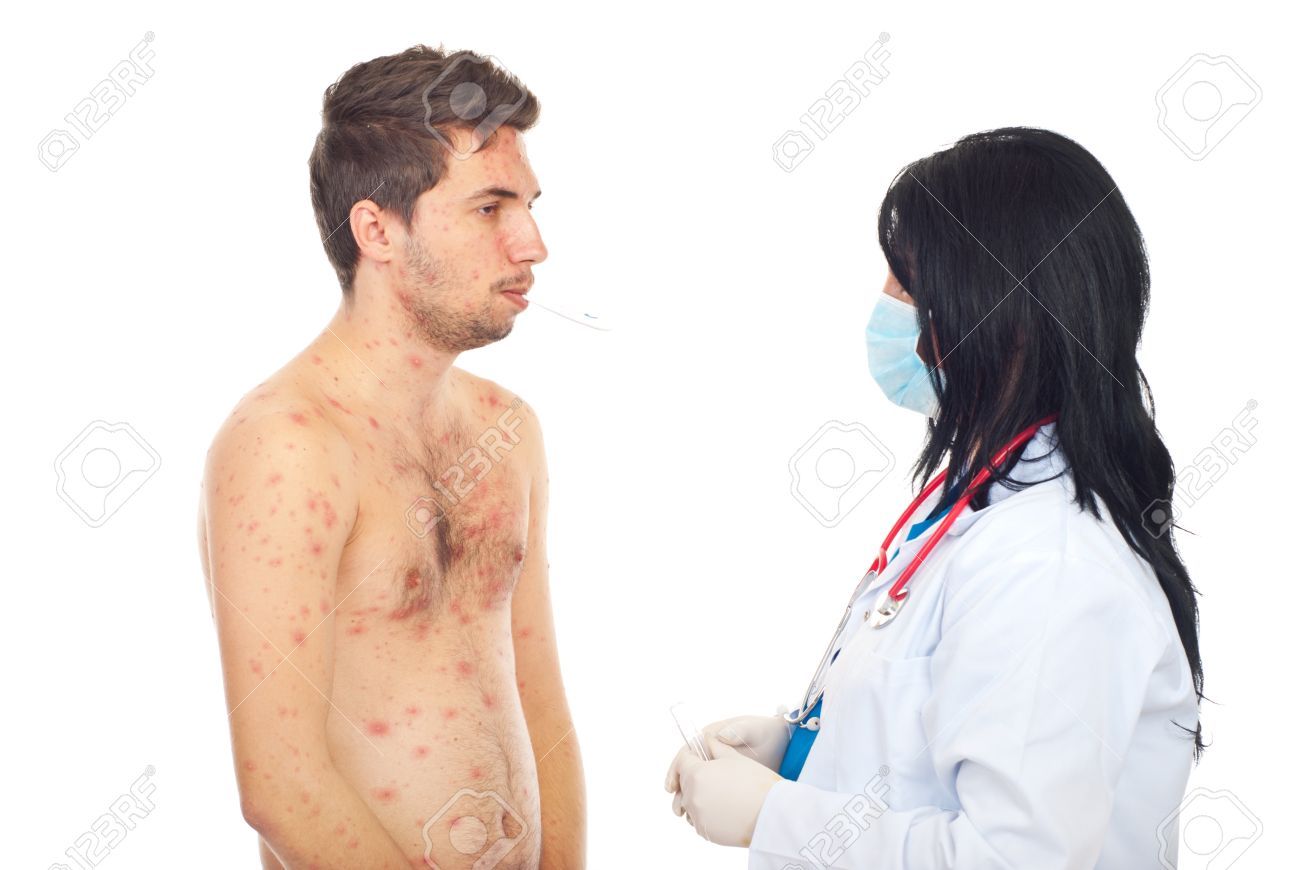 Doctor taking temperature to a sick male with chickenpox isolated on white background Stock Photo - 8383452