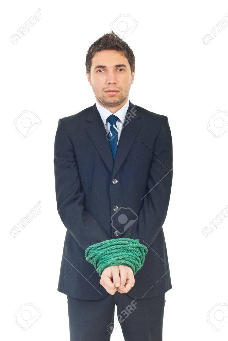 Sad executive man having his hands well linked looking at camera isolated on white background Stock Photo - 8375505