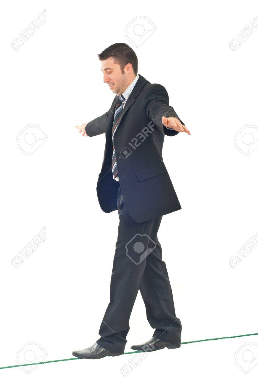 Business man on tightrope  concentrate to  walking isolatedon white background Stock Photo - 8375527