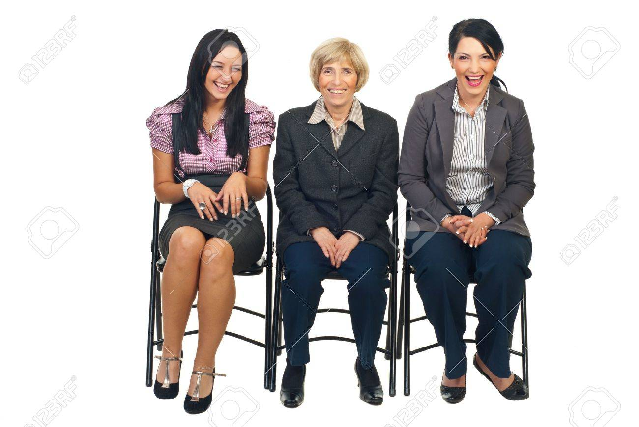 Three business women sitting on chairs view something and laughing out loud together isolated on white background Stock Photo - 8435981