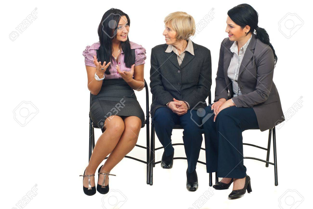 Three business women having a happy discussion at conference and sitting on chairs isolated on white background Stock Photo - 8493141