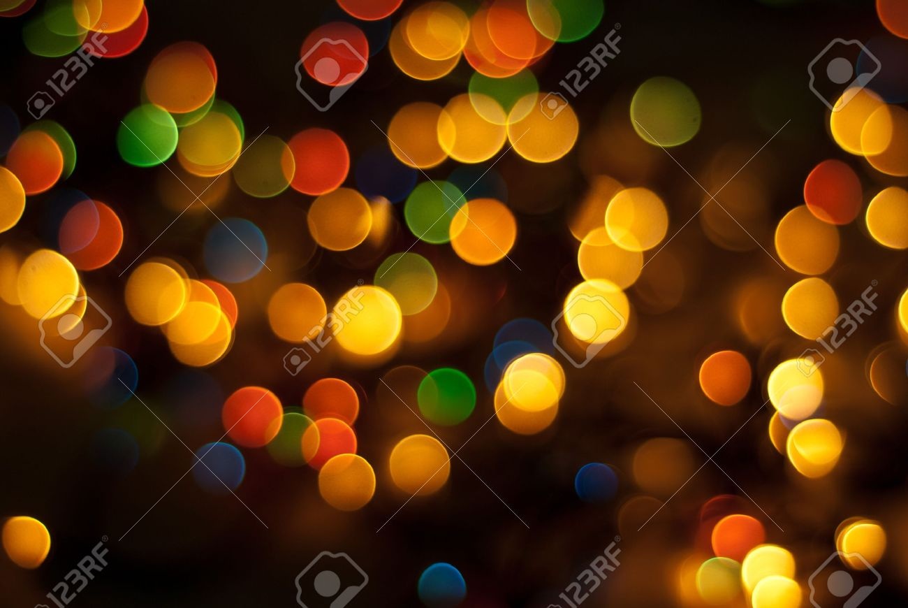 beautiful christmas tree lights in different colors background