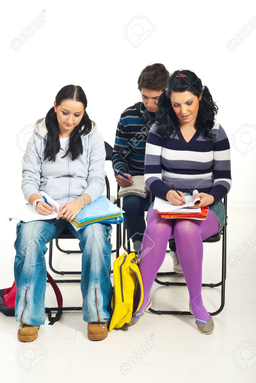 Students writing in notebooks at course in a classroom Stock Photo - 8586638