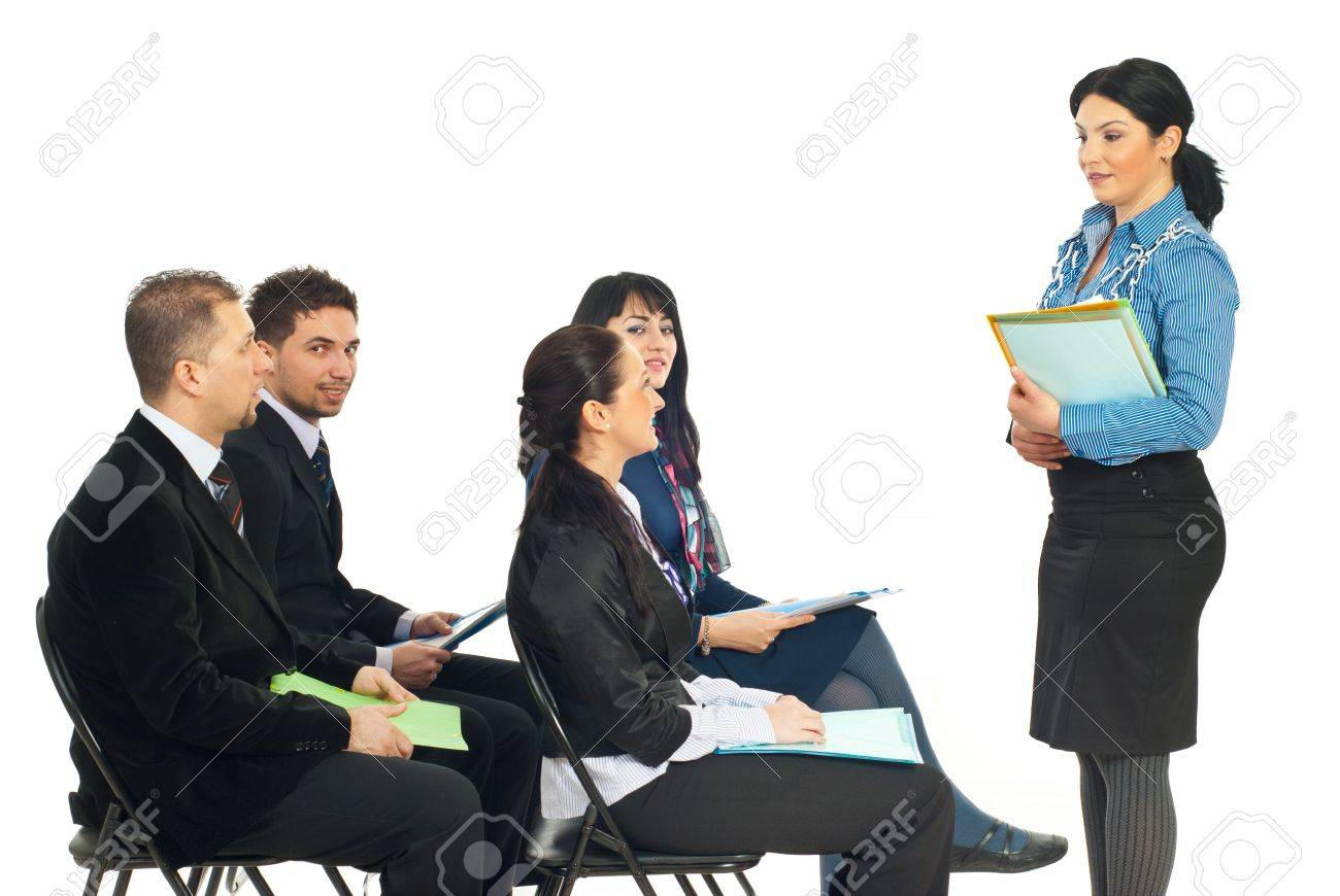 Four Business People At Training Seminar With Teacher Making ...