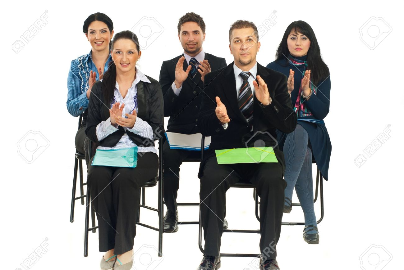 Five business people sitting on chairs at conference and applauding isolated on white background Stock Photo - 8805479