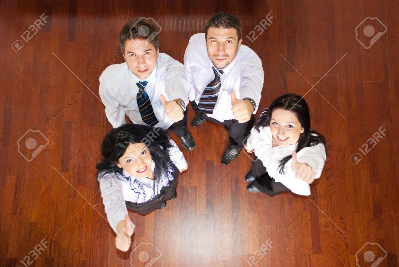 Top view of four business people giving thumbs and looking up Stock Photo - 8902711