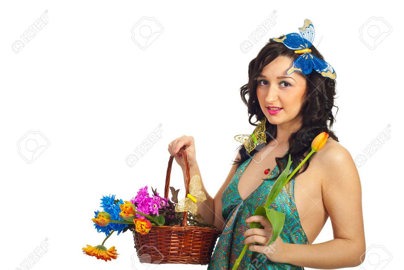 Nice spring girl holding fresh flowers in a basket and a tulip in her hand isolated on white background Stock Photo - 9057862