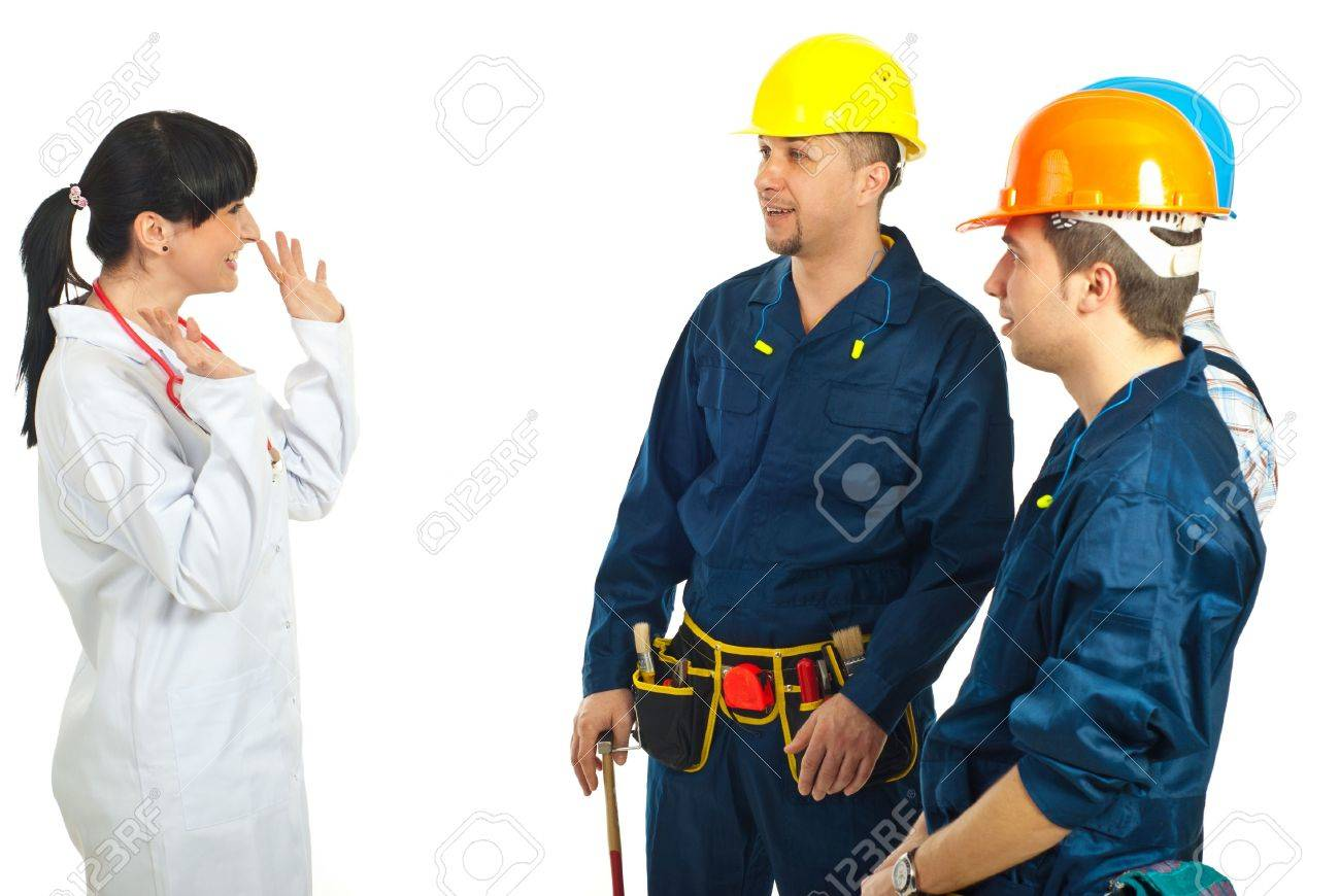 Doctor woman having happy conversation with workers team and showing her hands against white background Stock Photo - 9122605