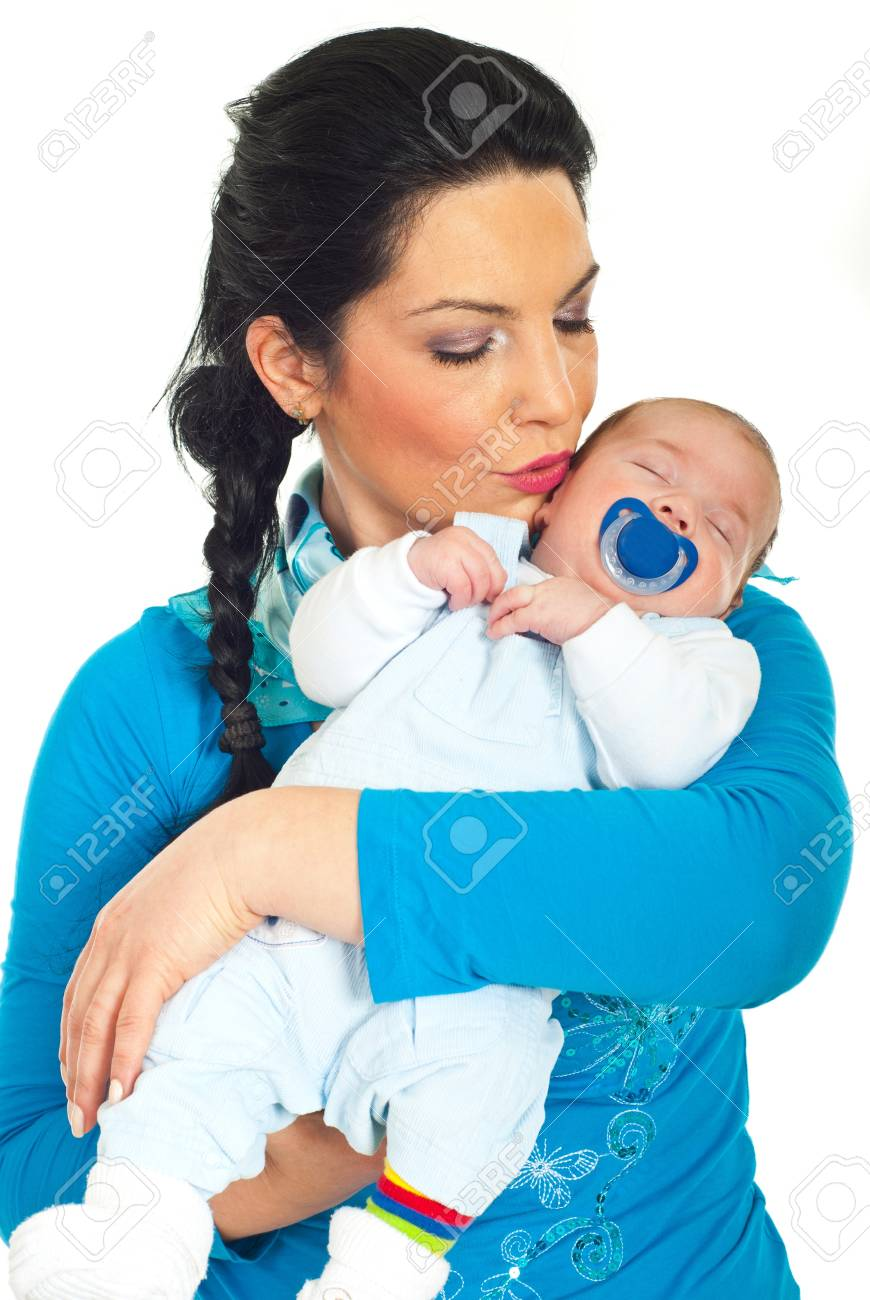 Mother kissing her sleeping newborn baby over white background Stock Photo - 9122667