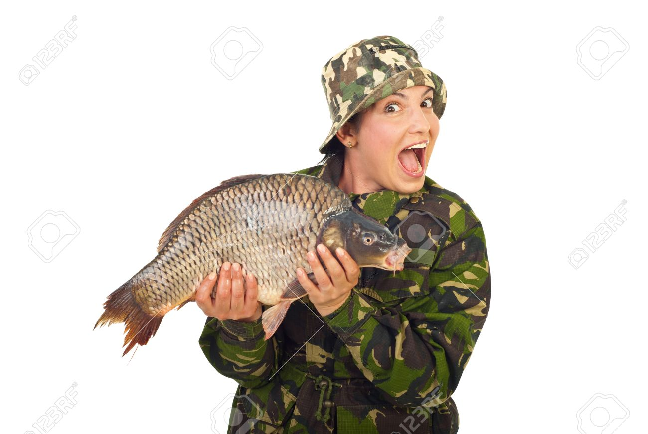 Amazed happy fisher woman holding big carp isolated on whiote background Stock Photo - 9741825