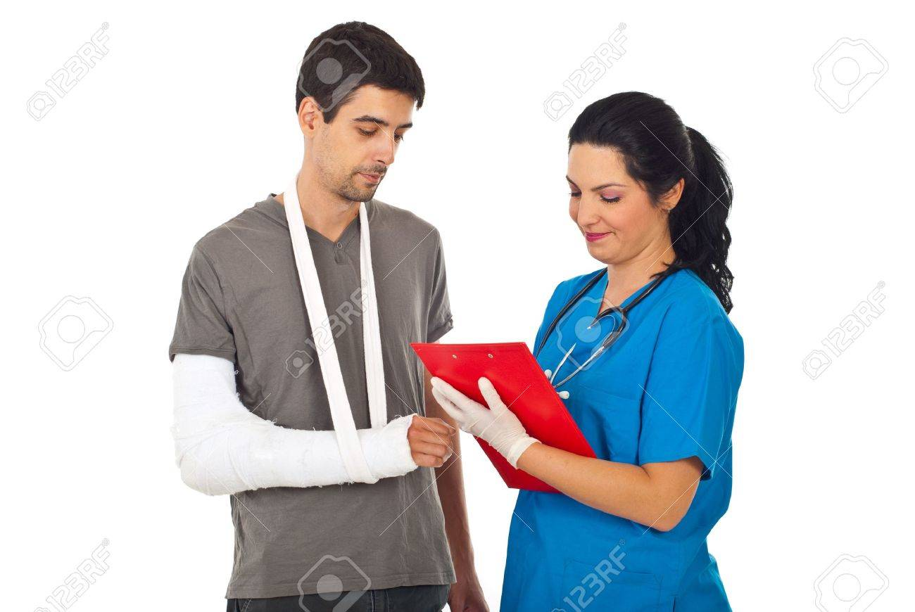 Friendly doctor woman giving prescription to injured man and writing in clipboard isolated on white background Stock Photo - 9886228