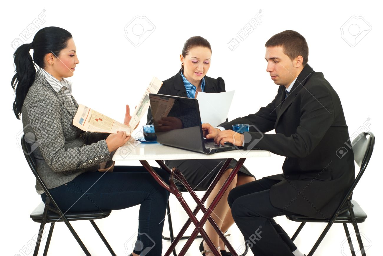 Group Of Three Business People Sitting At Table In A Cafe Shop And Reading Newspaper