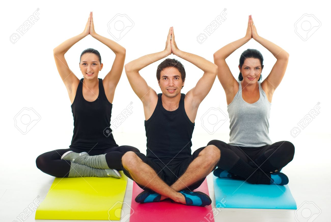 Group Of Three People Doing Yoga On Colorful Gymnastics Mats Stock Photo Picture And Royalty Free Image Image 10589962