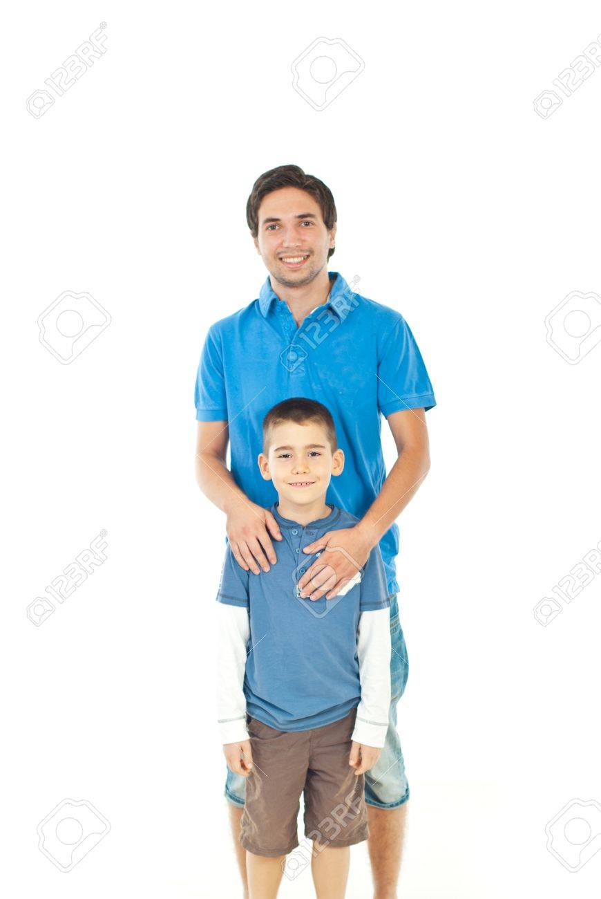 4ffb8eff9 Smiling father and his son standing together against white  background,selective focus on kid Stock