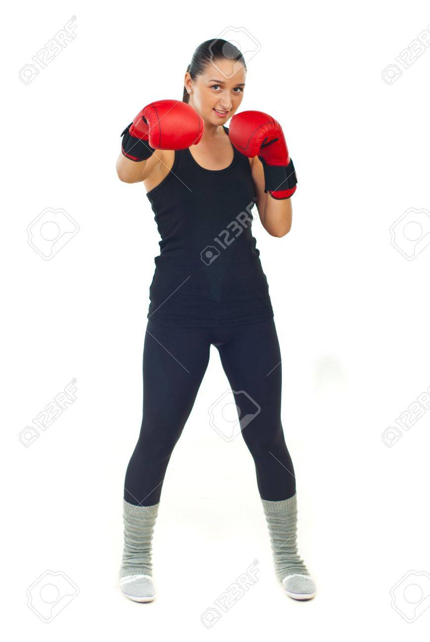 Full length of boxer female with red boxing gloves standing in defensive position isolated on white background Stock Photo - 10748209