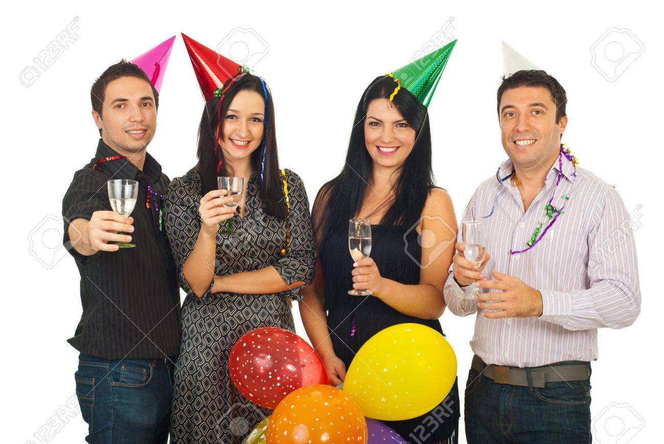 Group Of Four Friends Celebrating New Year\'s Eve Together And ...
