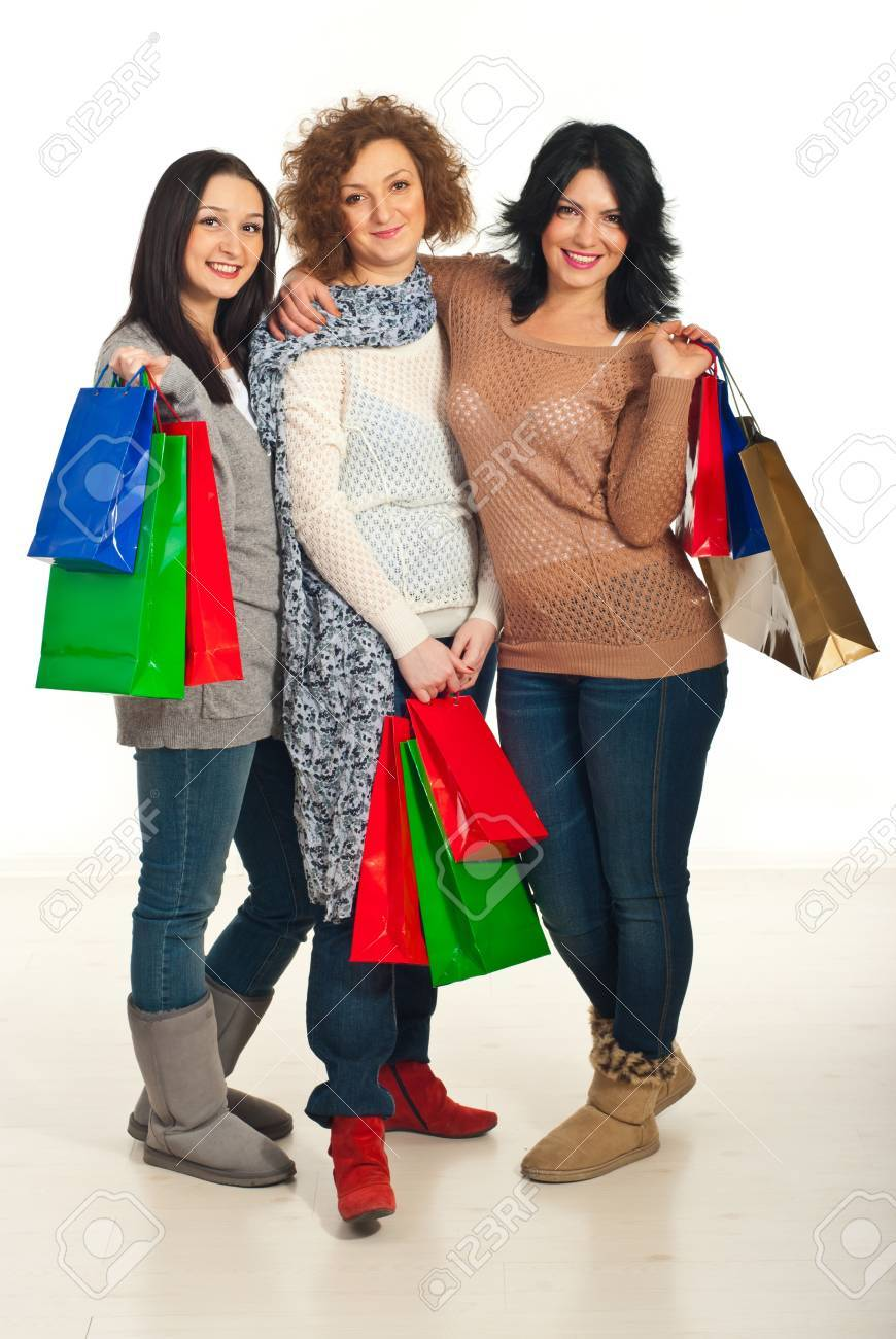 United three friends women holding shopping bags and standing in embrace Stock Photo - 11756055