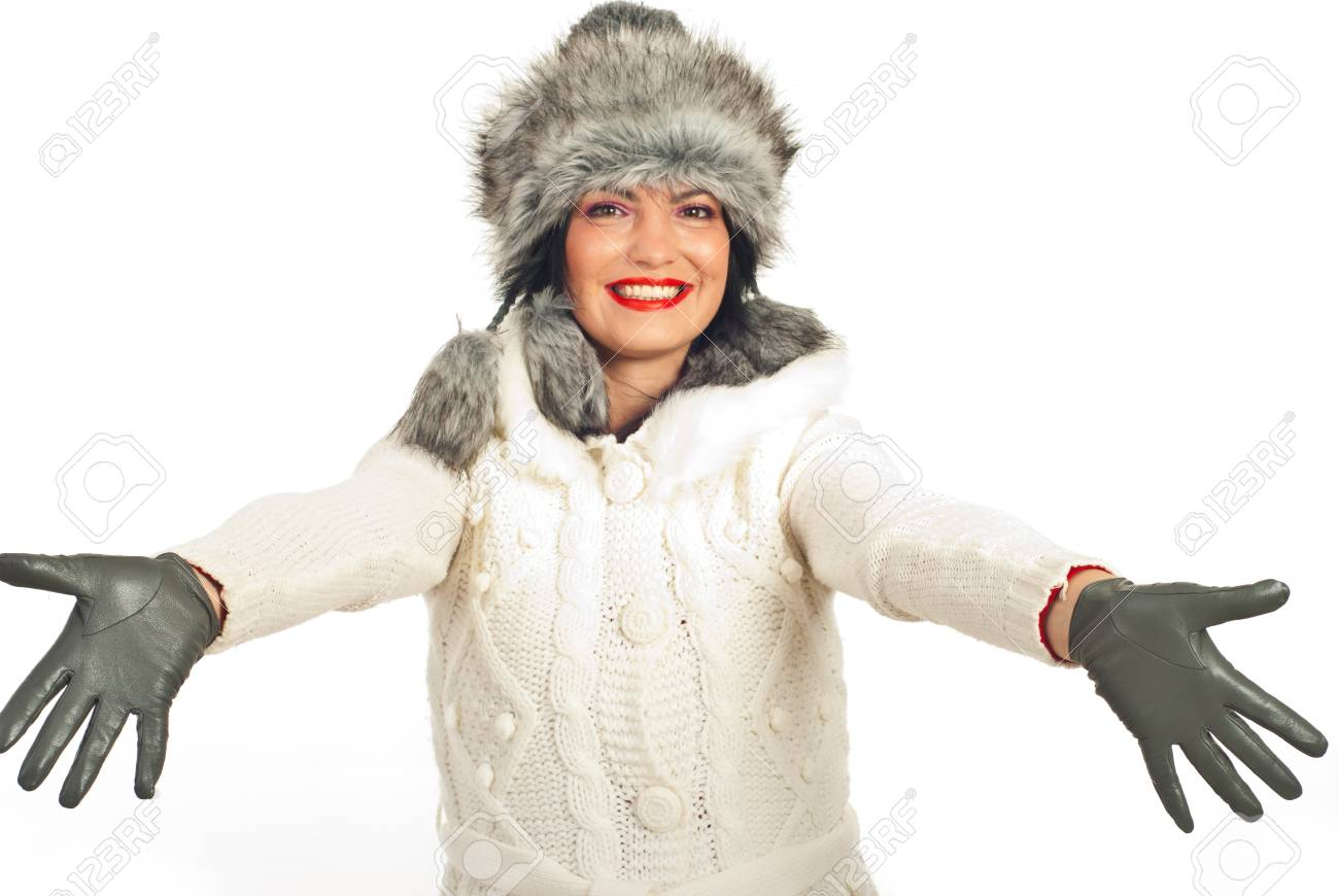 Hapopy winter woman opening hands to you isolated on white background Stock Photo - 11756072