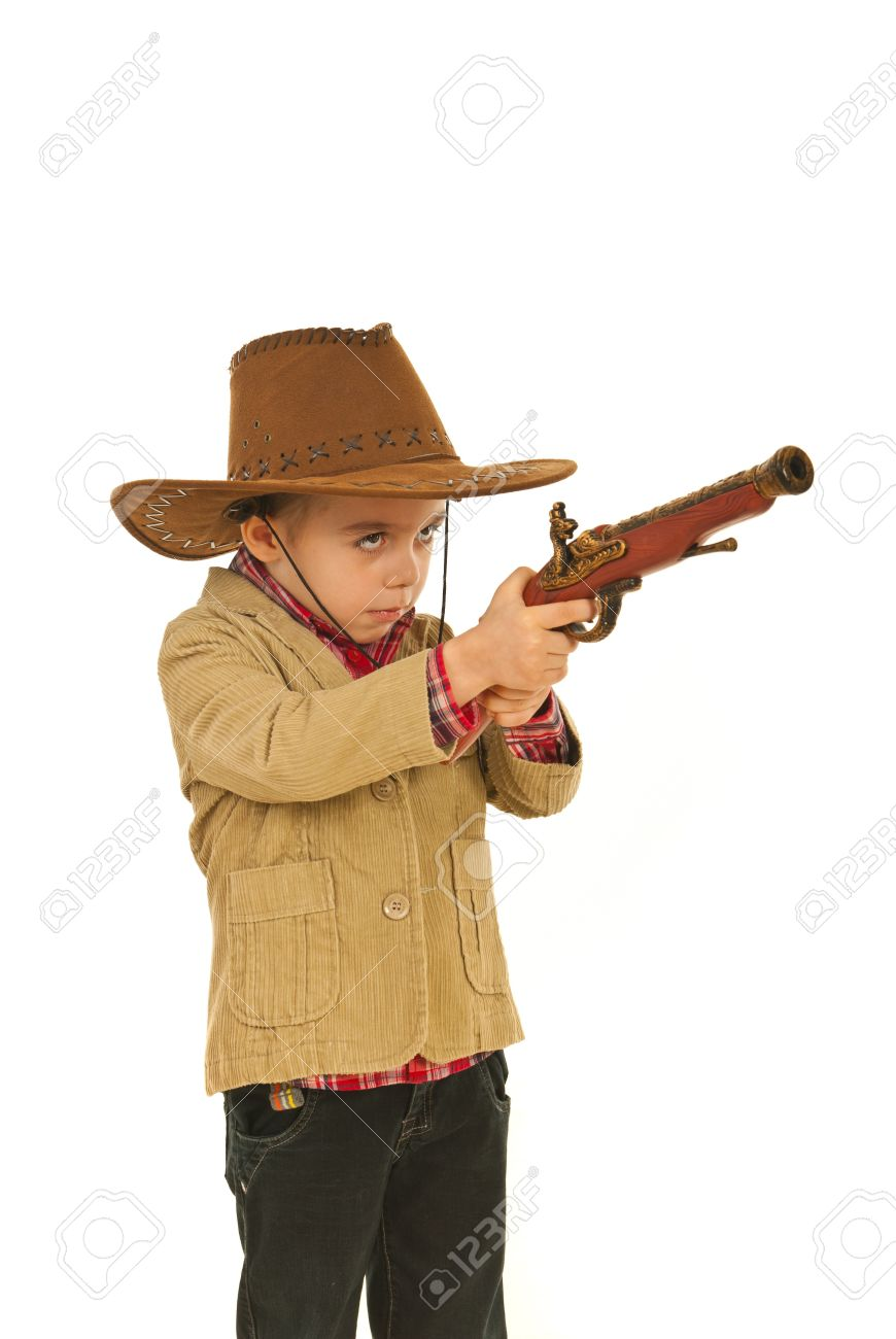Small cowboy boy with hat playing with gun toy isolated on white background Stock Photo - 12595119
