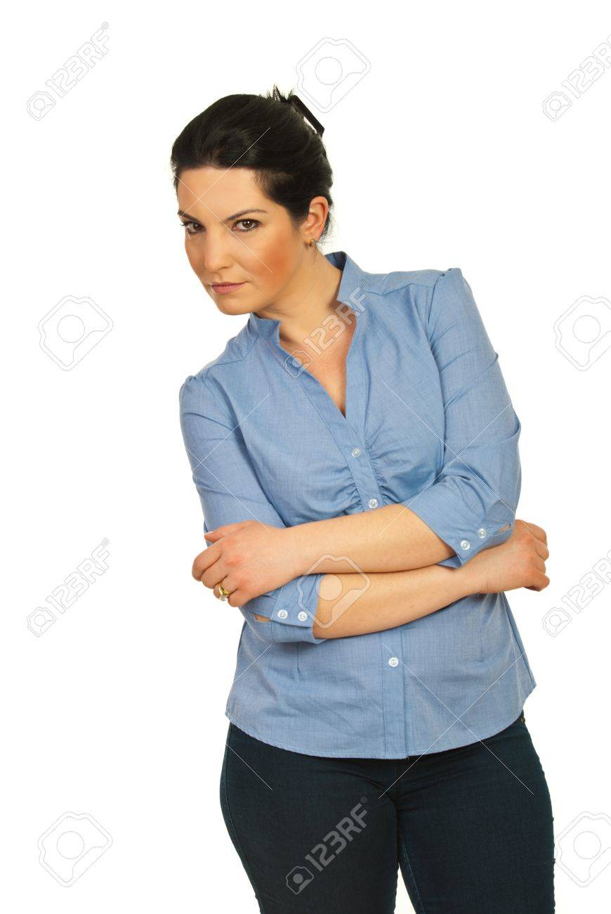 Business woman standing with arms folded and looking suspicious isolated on white background Stock Photo - 12922645