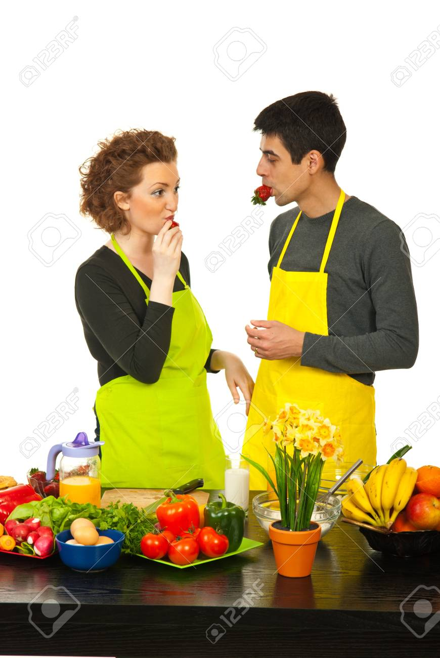 Couple eating strawberries in kitchen isolated onw hite background Stock Photo - 13367317