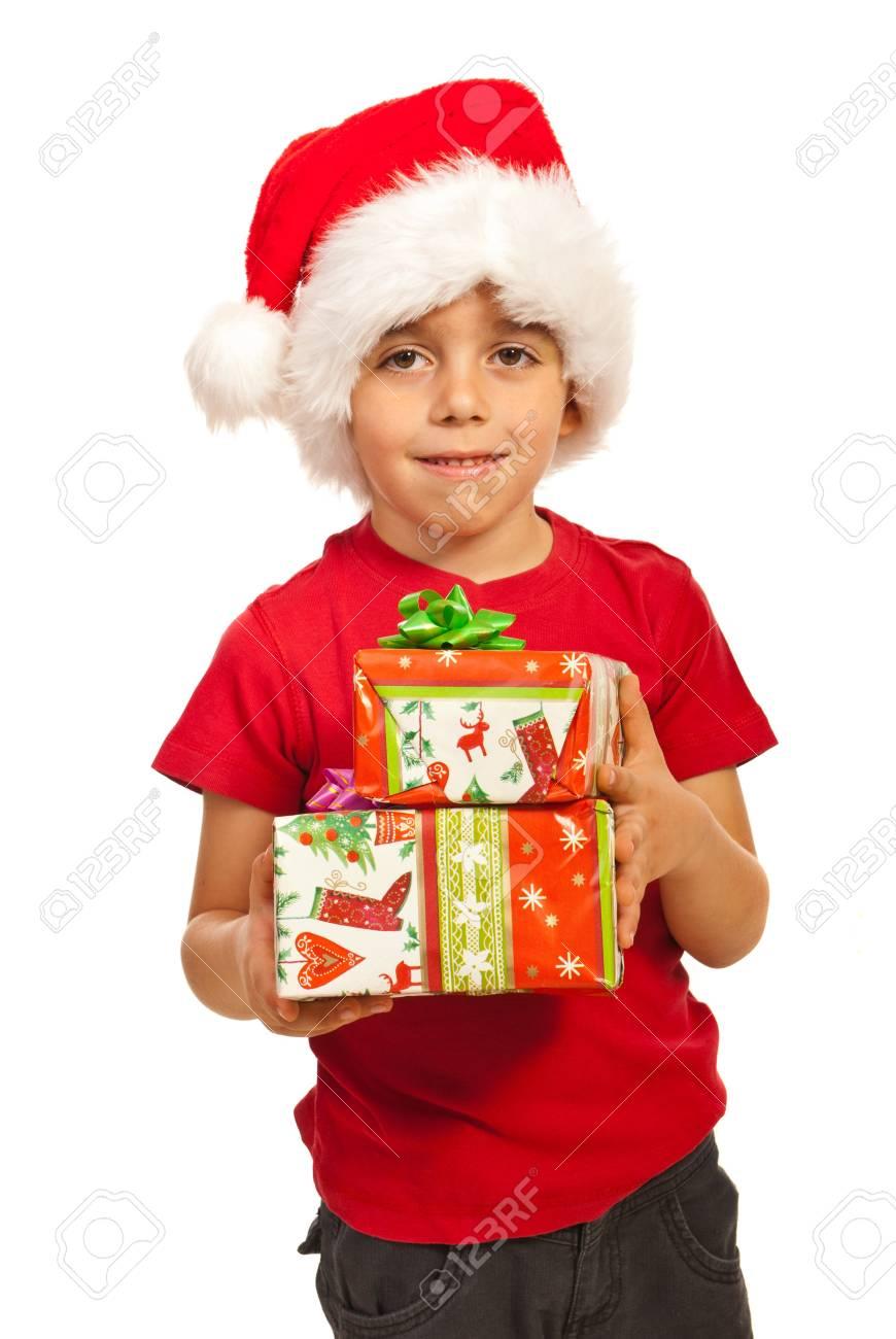 Smiling boy with Santa ha holding Xmas gifts isolated on white background Stock Photo - 16129707