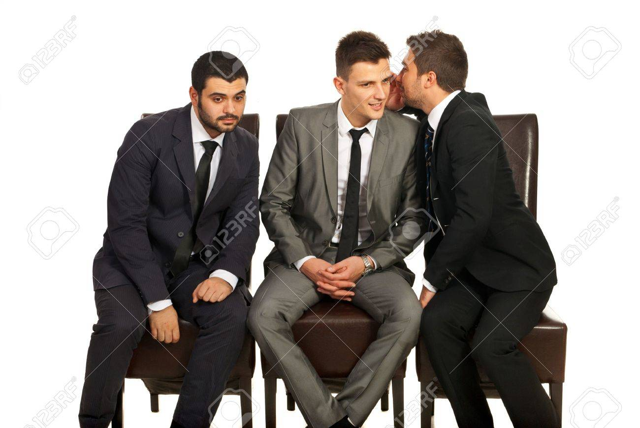 Business man sharing a secret to his colleague and the other trying to hear isolated on white background Stock Photo - 17034072