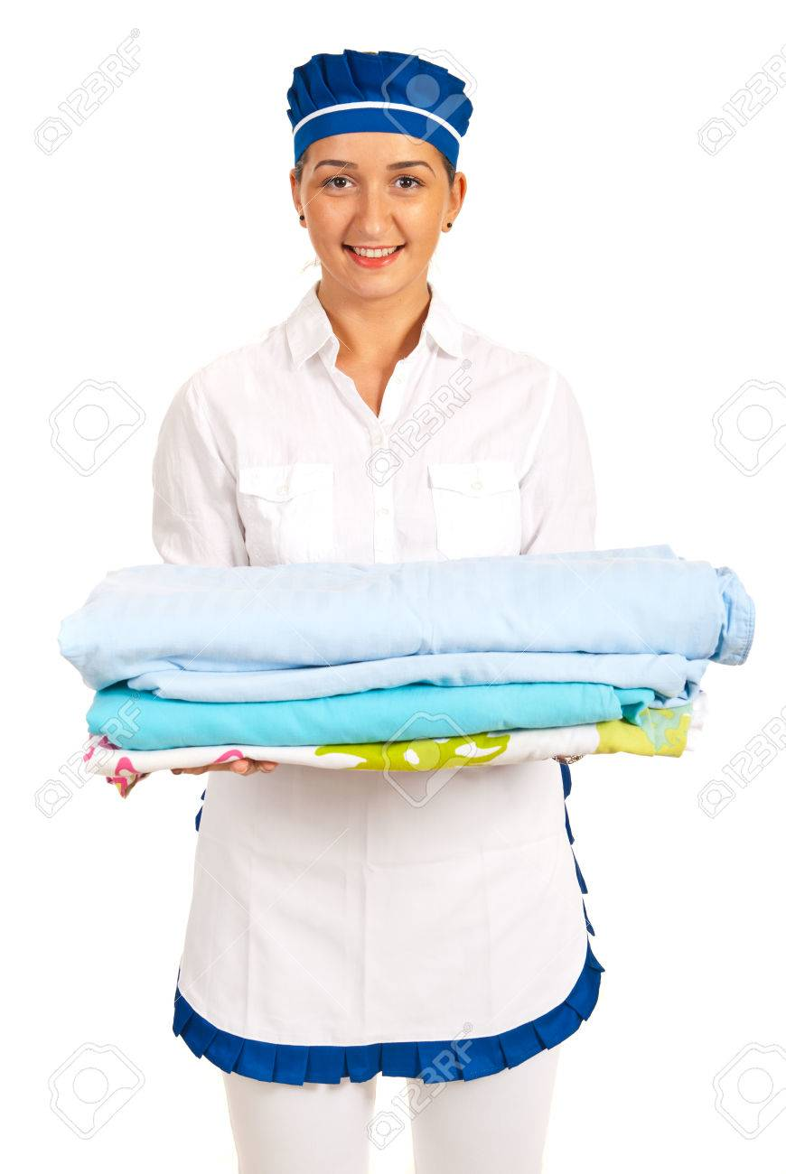 Happy hotel maid ready to change beds isolated on white Stock Photo - 22610345