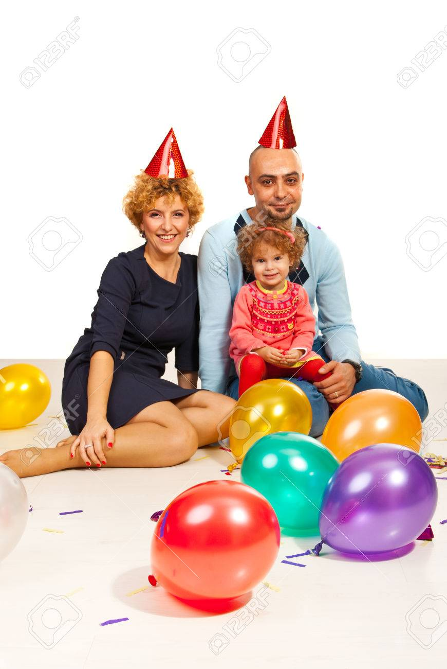 Party family with toddler girl  against white background Stock Photo - 22997852