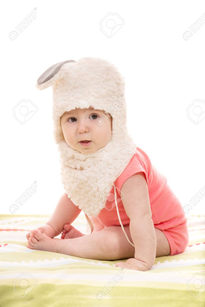 5e591b7c5 Little Baby Girl Sitting And Wearing Bunny Hat Isolated On White ...