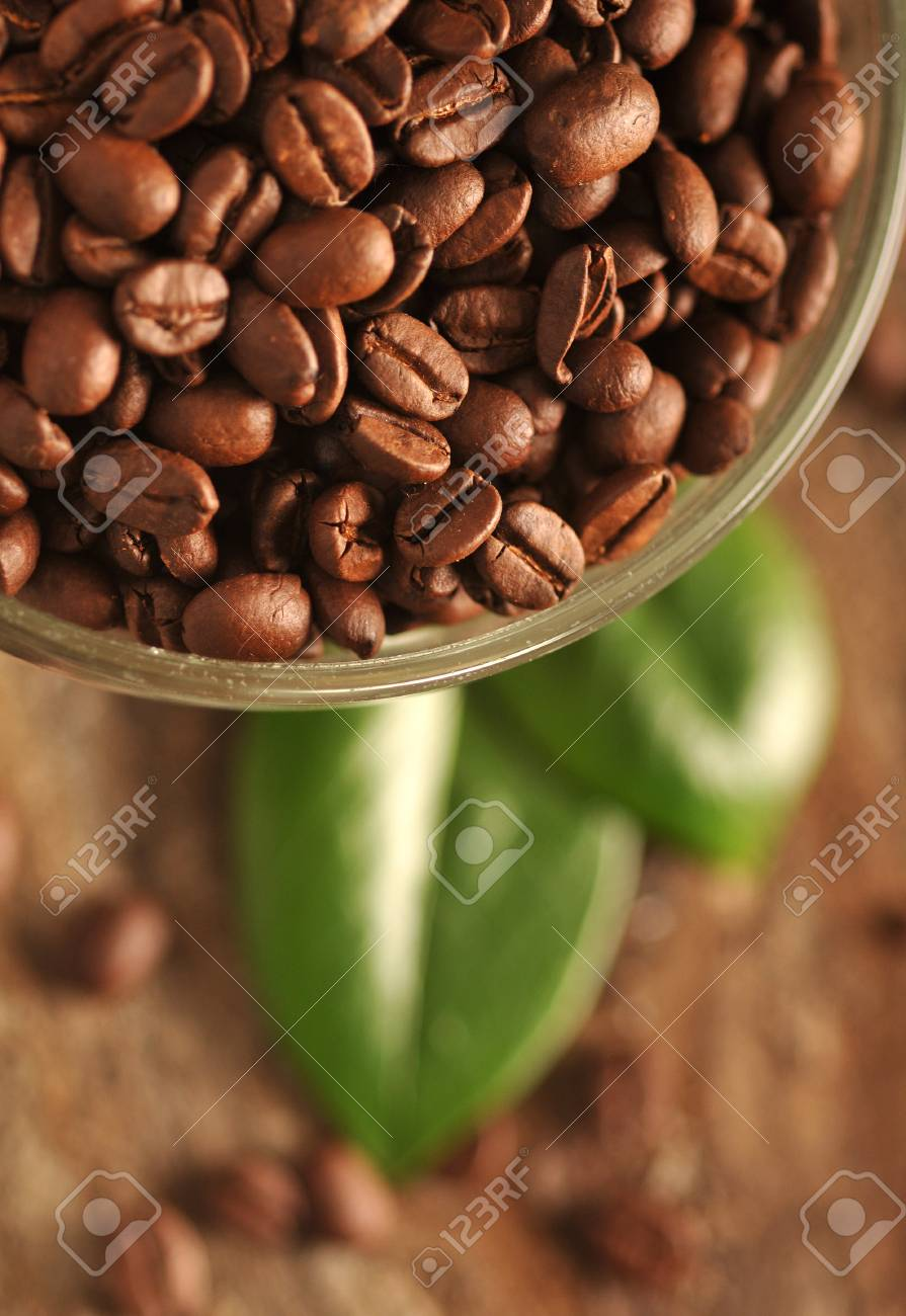 Coffee beans with leaves on the wooden board Stock Photo - 16963453