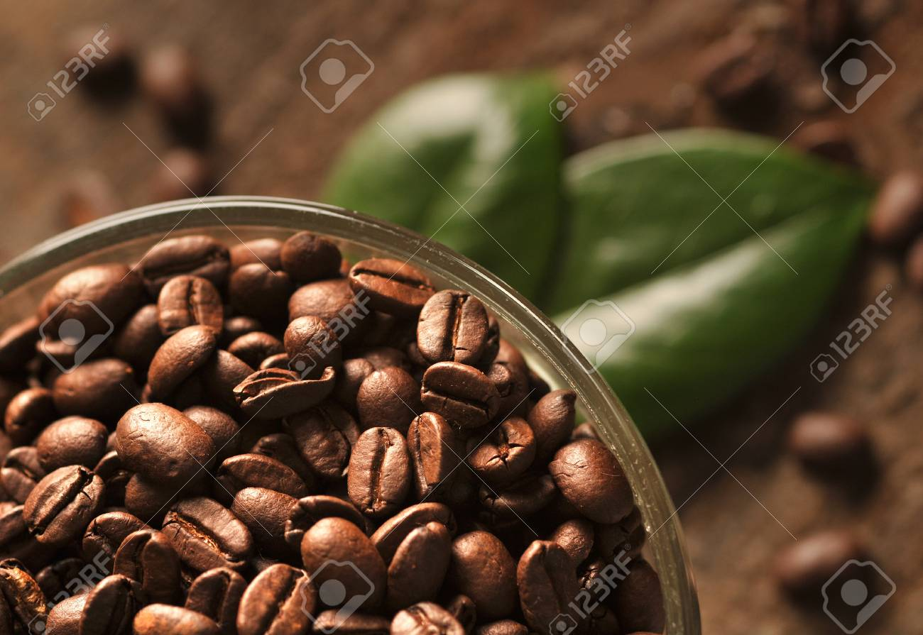Coffee beans with leaves on the wooden board Stock Photo - 16963458