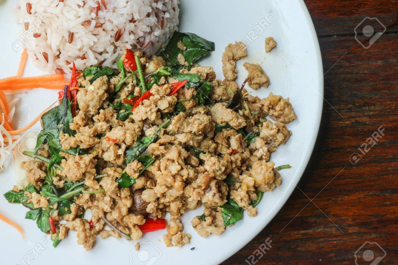 Rice And Stir Fried Pork Holy Basil (Thai Food) - Close Up Of Rice Topped  With Stir Fried Minced Pork And Holy Basil Stock Photo, Picture And Royalty  Free Image. Image 61707368.