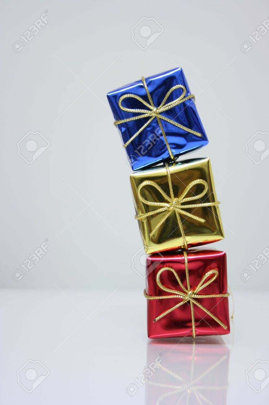 Three presents in shiny wrapper Stock Photo - 6165659