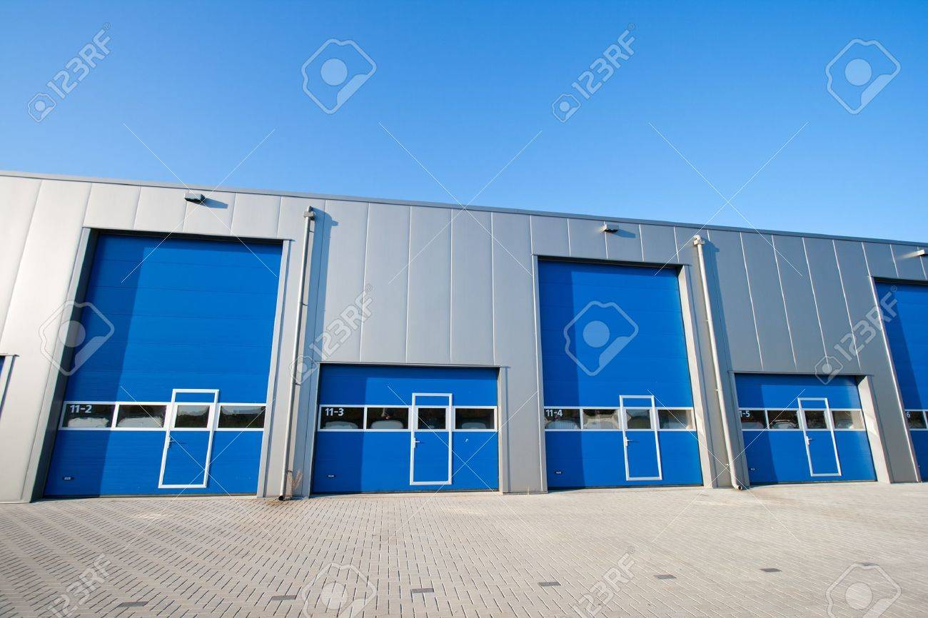 industrial unit with roller shutter doors stock photo