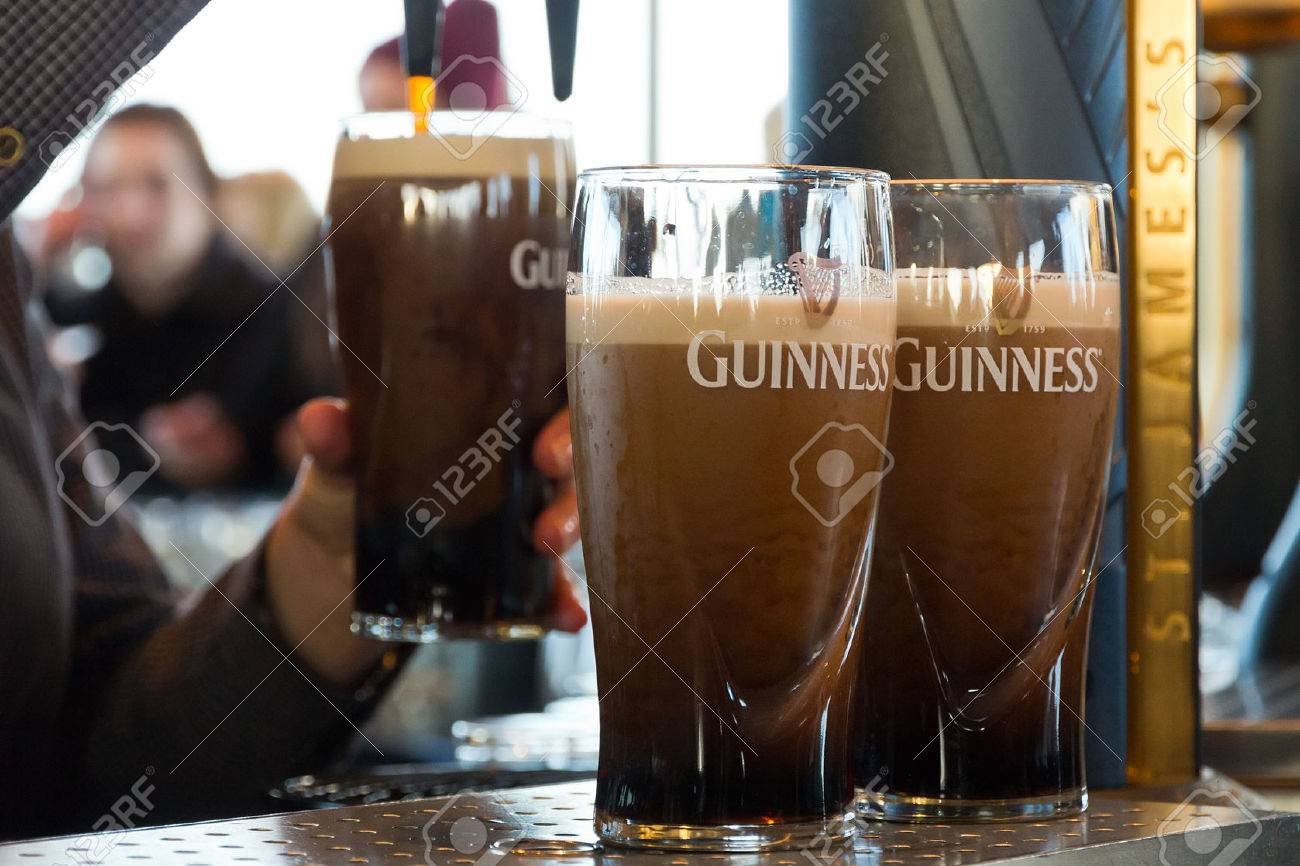 DUBLIN, IRELAND - FEB 15, 2014: Pints of beer are served at The Guinness Brewery on Feb 15, 2014. The brewery where 2.5 million pints of stout are brewed daily was founded by Arthur Guinness in 1759. - 26278196