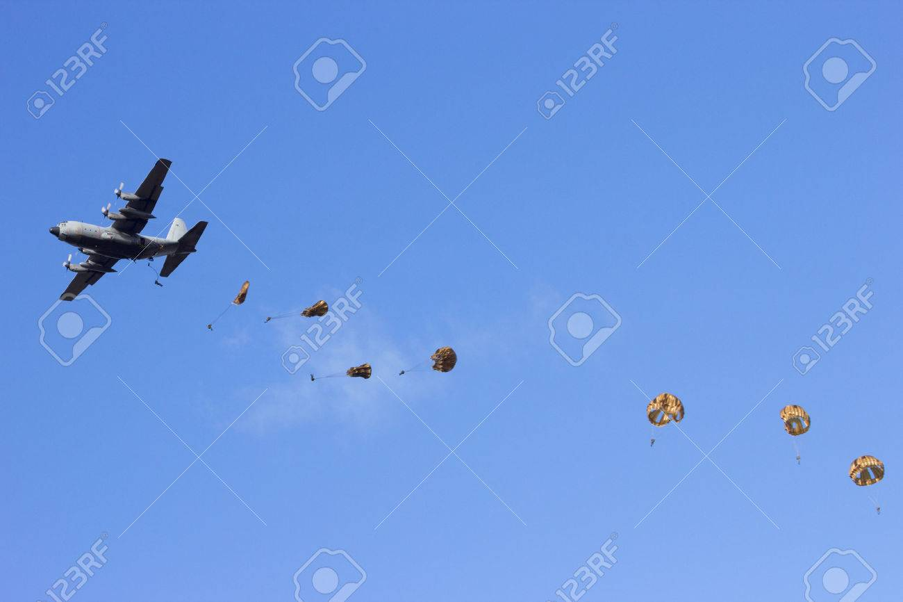 Military plane dropping paratroopers - 56560970