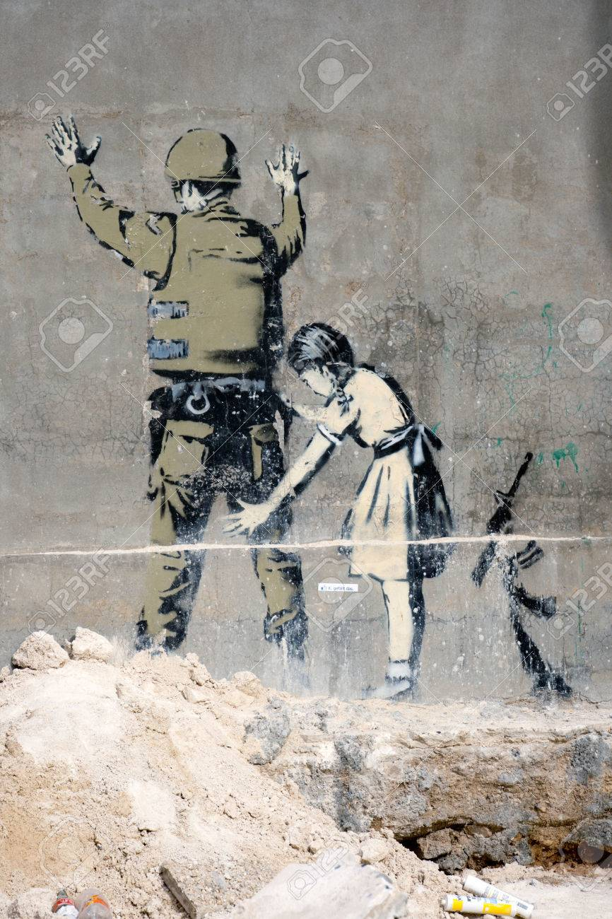 BETHLEHEM, PALESTINIAN TERRITORIES - JANUARY 25: Banksy grafitti on a wall in the occupied territories. Bethlehem, JANUARY 25, 2010. - 60736137